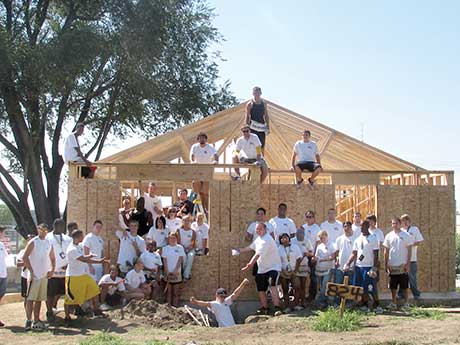 Students working on a Habitat for Humanity house