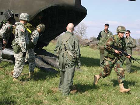 Members of the ROTC exit a cargo plane