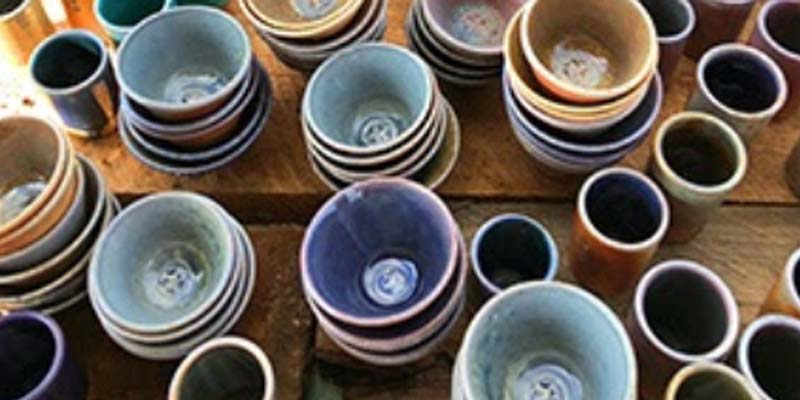 Clay bowls and cups made by MWSU art students