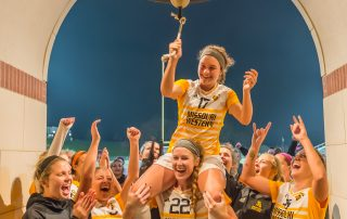 The Griffons celebrate at the victory bell